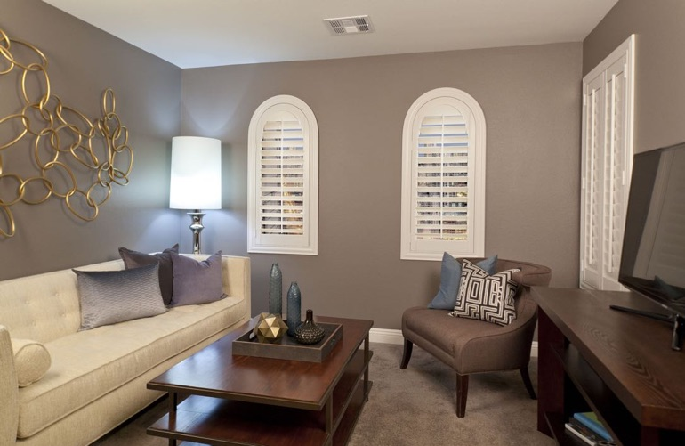 Indianapolis family room with arced plantation shutters.
