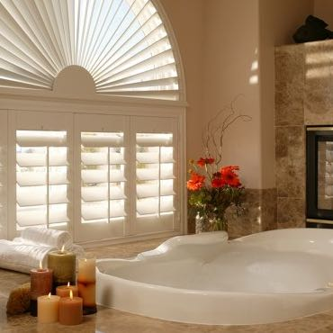 Indianapolis bathroom with window shutters.