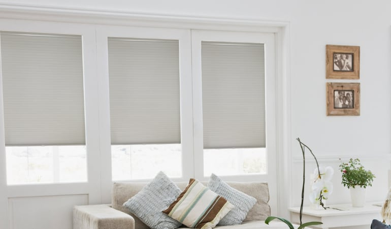 Cellular shades in a living room.