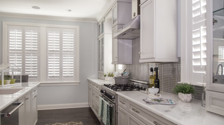 White shutters in Indianapolis kitchen with modern appliances.