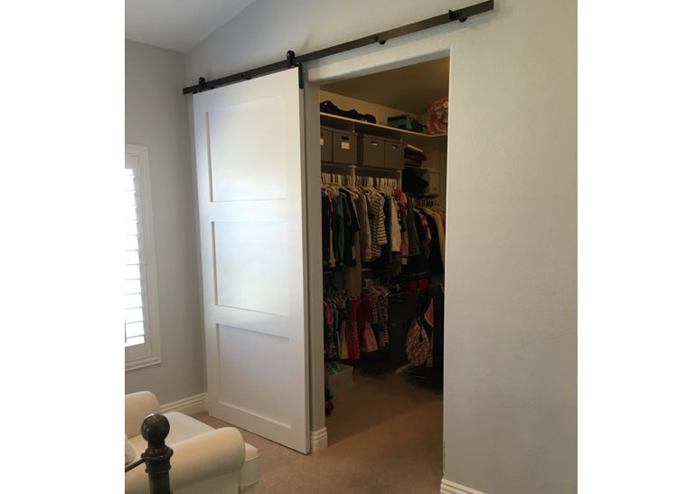 White barn door used as closet door