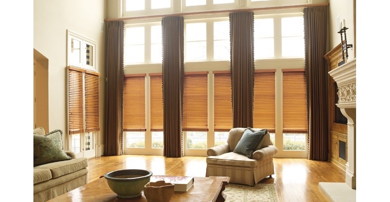 Indianapolis great room with wooden blinds and full-length drapes.