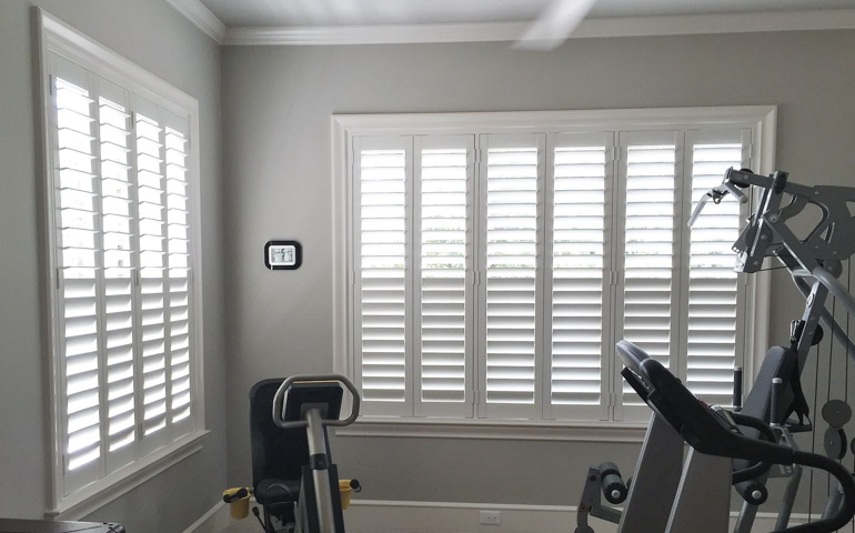 Indianapolis home gym with shuttered windows.