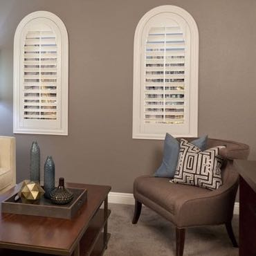 Indianapolis family room with arch window shutters.
