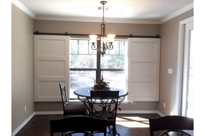 Indianapolis dining room with classic barn door shutters.