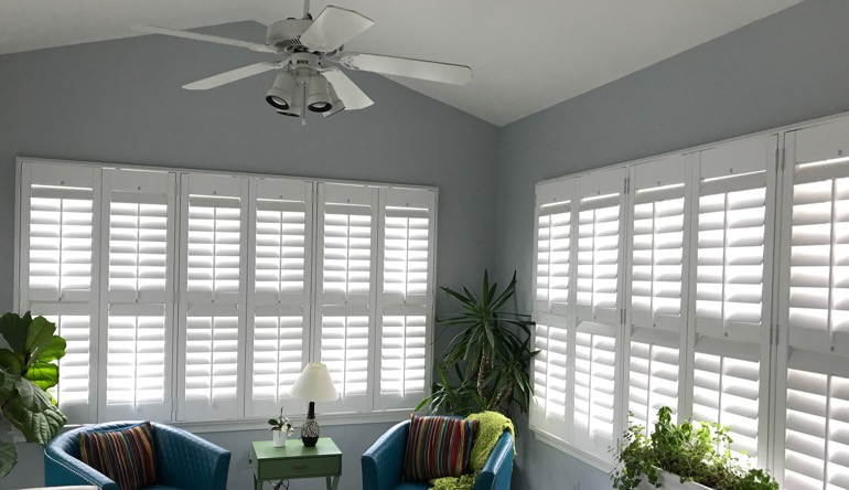 Indianapolis sunroom with fan and shutters