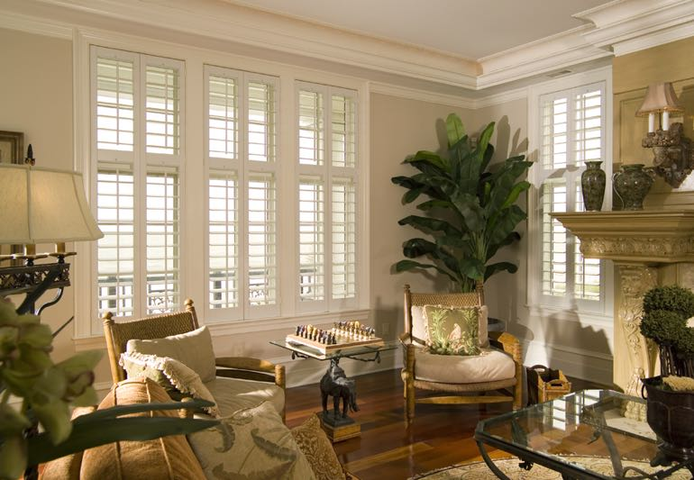 Living Room Interior With Hardwood Floors And Plantation Shutters