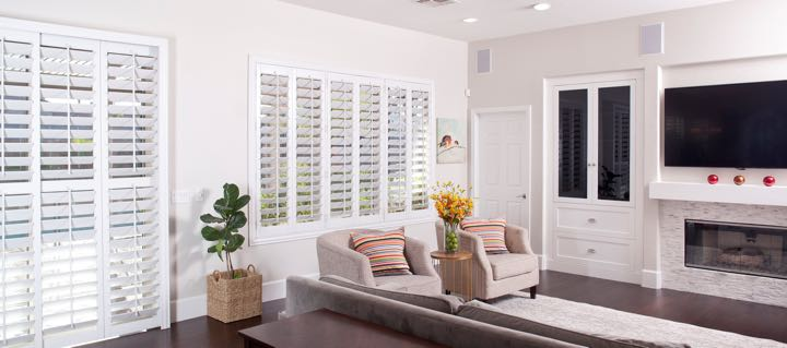 Indianapolis living room in white with plantation shutters.