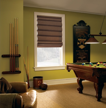 Roman shades in Indianapolis rec room with green walls.