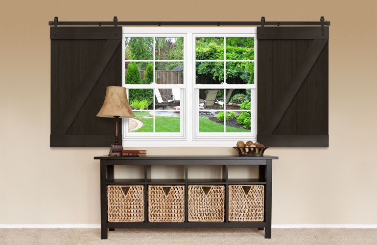 Dark brown Z-frame sliding barn doors on a window