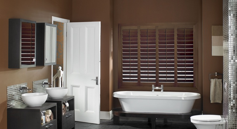 Stained wood shutter in Indianapolis bathroom