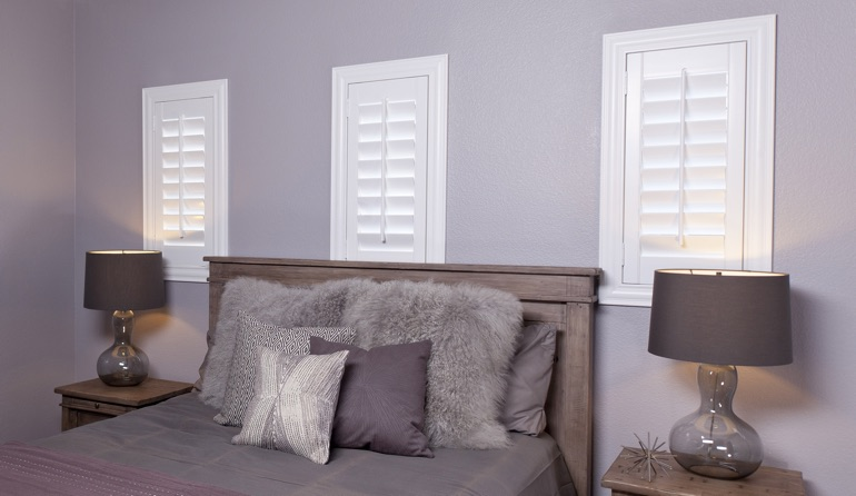 White plantation shutters in Indianapolis bedroom windows.