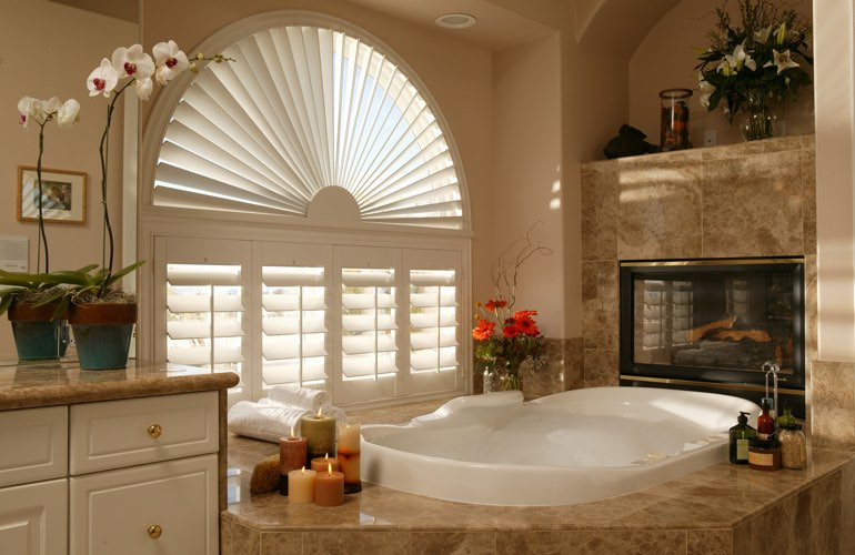 Arched shutters in a Indianapolis bathroom.
