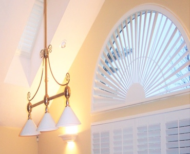 Indianapolis arched eyebrow window with plantation shutter