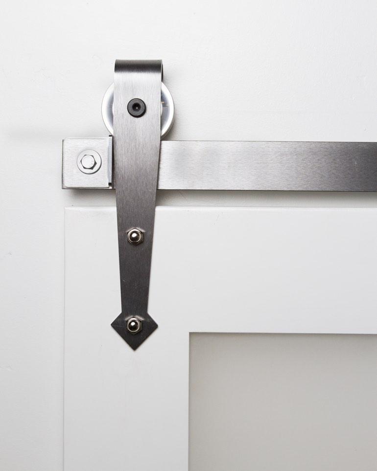 metal mini arrow hanger on white barn door mini arrow black mini industrial hanger on stained sliding barn door