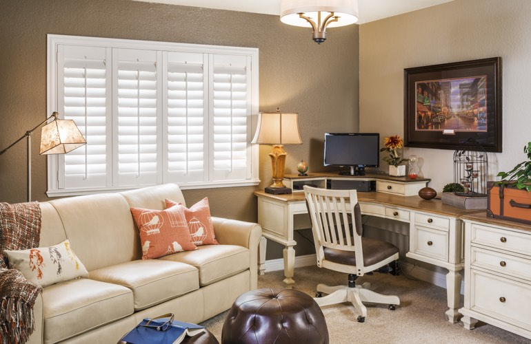 Indianapolis home office with white window shutters.