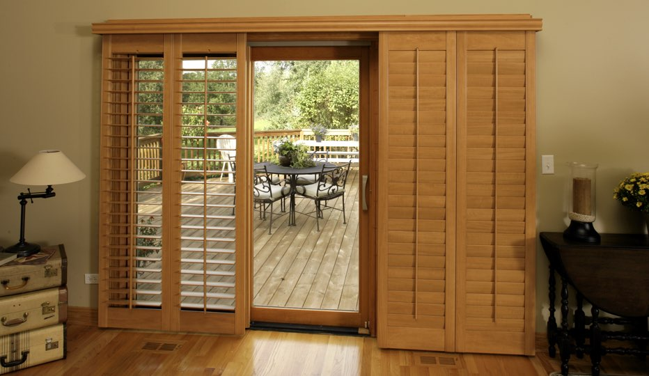 Bypass wood patio door shutters in Indianapolis living room