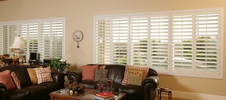 Wide window with plantation shutters in Indianapolis living room