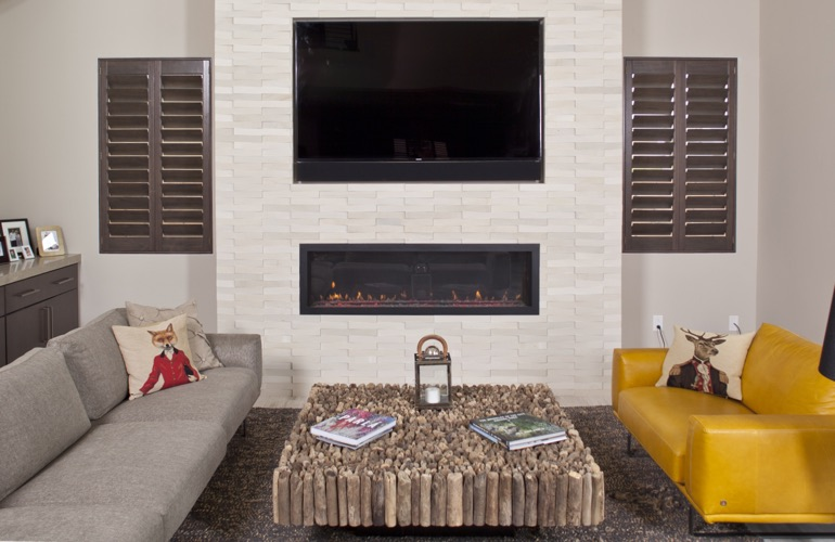 Ovation wood shutters in living room with fireplace